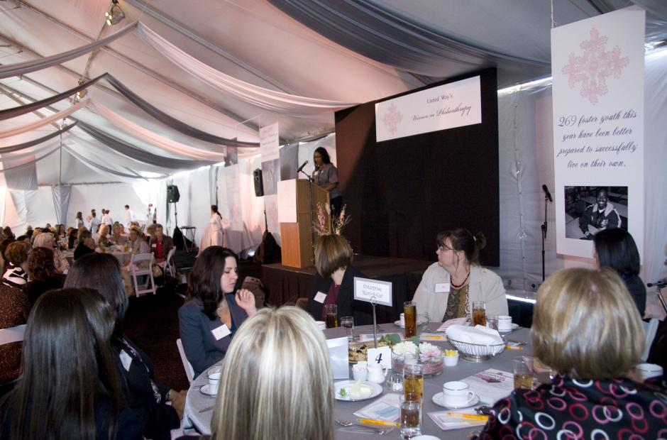 September speaking in front of crowd during 2008 lunchon